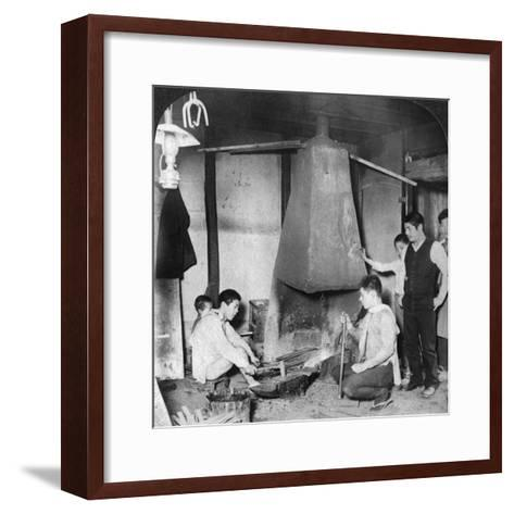 A Japanese Blacksmith at His Forge, Yokohama, Japan, 1904-Underwood & Underwood-Framed Art Print