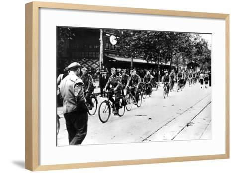German Soldier Cycling Through the Streets of Paris, June 1940--Framed Art Print