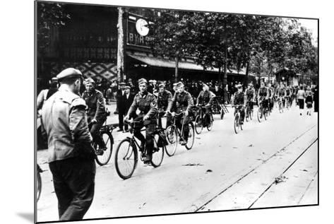 German Soldier Cycling Through the Streets of Paris, June 1940--Mounted Photographic Print