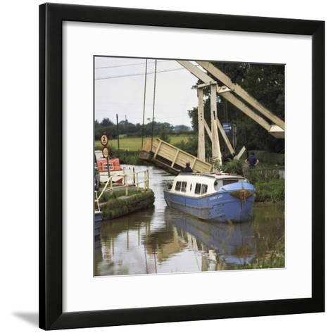 A Canal Boat Passing under a Lift Bridge on the Llangollen Canal, 1970-Michael Walters-Framed Art Print