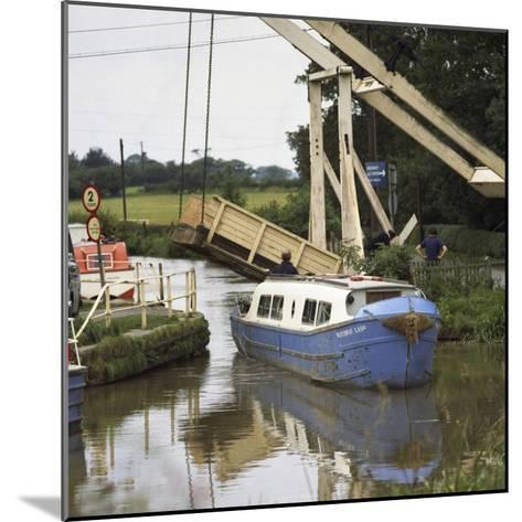 A Canal Boat Passing under a Lift Bridge on the Llangollen Canal, 1970-Michael Walters-Mounted Photographic Print