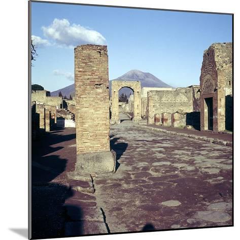 Road Leading to Arch of Caligula with Vesuvius Beyond, Pompeii, Italy-CM Dixon-Mounted Photographic Print