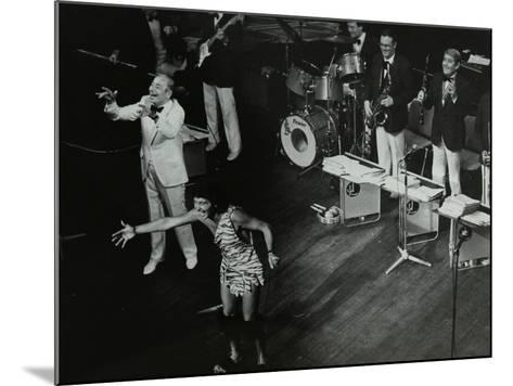 Joe Loss (Left) on Stage with His Orchestra at the Forum Theatre, Hatfield, Hertfordshire, 1986-Denis Williams-Mounted Photographic Print