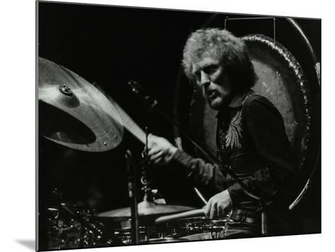 Drummer Ginger Baker Performing at the Forum Theatre, Hatfield, Hertfordshire, 1980-Denis Williams-Mounted Photographic Print