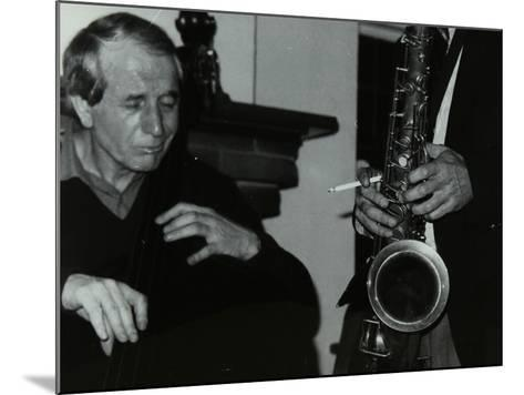 Phil Bates and the Tenor Saxophone of Spike Robinson at the Bell, Codicote, Hertfordshire, 1986-Denis Williams-Mounted Photographic Print