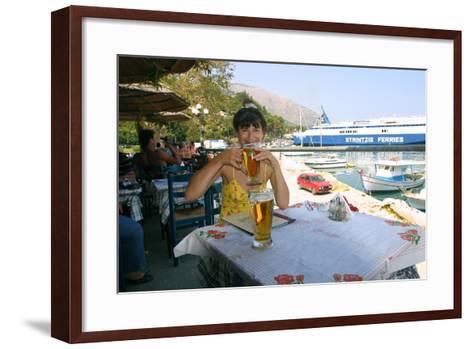 Woman Enjoying a Drink in a Harbourside Taverna, Poros, Kefalonia, Greece-Peter Thompson-Framed Art Print