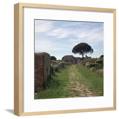Street and Buildings in the Roman Town of Ostia, 2nd Century-CM Dixon-Framed Art Print