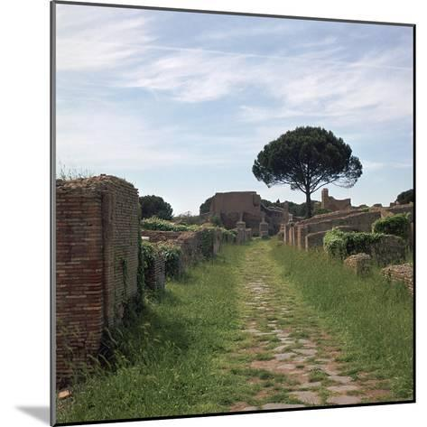 Street and Buildings in the Roman Town of Ostia, 2nd Century-CM Dixon-Mounted Photographic Print