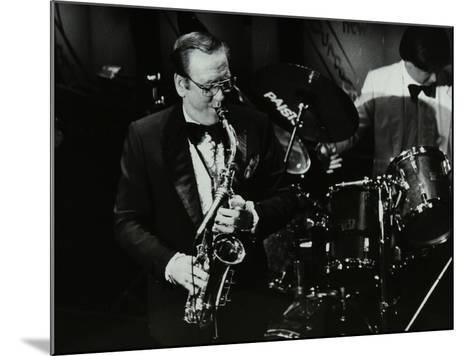 Harry Bence Playing the Saxophone at the Forum Theatre, Hatfield, Hertfordshire, 1984-Denis Williams-Mounted Photographic Print