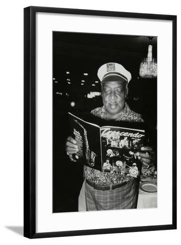 Count Basie Reading a Copy of Crescendo Magazine at the Grosvenor House Hotel, London, 1979-Denis Williams-Framed Art Print