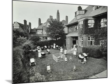 Children and Carers in a Garden, Hampstead, London, 1960--Mounted Photographic Print