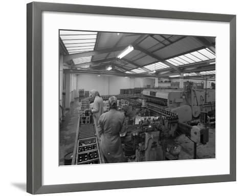 The Final Process of Bottling Beer, Ward and Sons Bottling Plant, Swinton, South Yorkshire, 1960-Michael Walters-Framed Art Print