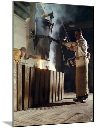 Teeming Iron into Ingots, J Beardshaw and Sons, Sheffield, South Yorkshire, 1963-Michael Walters-Mounted Photographic Print