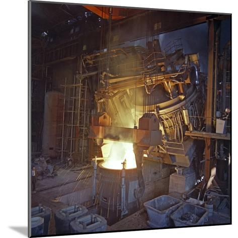 75 Ton Arc Furnace Pouring Molten Steel into a Vessel, Sheffield, South Yorkshire, 1969-Michael Walters-Mounted Photographic Print