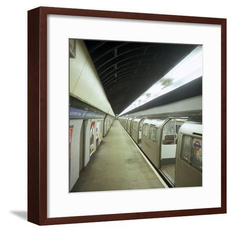 Tube Train Standing at Blackhorse Road Station on the Victoria Line, London, 1974-Michael Walters-Framed Art Print