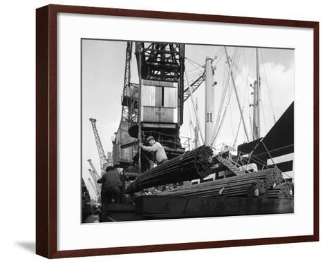 Dockers Loading Steel Bars onto the Manchester Renown, Manchester, 1964-Michael Walters-Framed Art Print