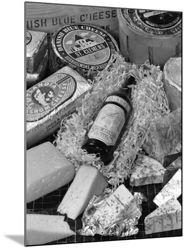 A Selection of Danish Cheeses and a Bottle of Aalborg Aquavit, 1963-Michael Walters-Mounted Photographic Print
