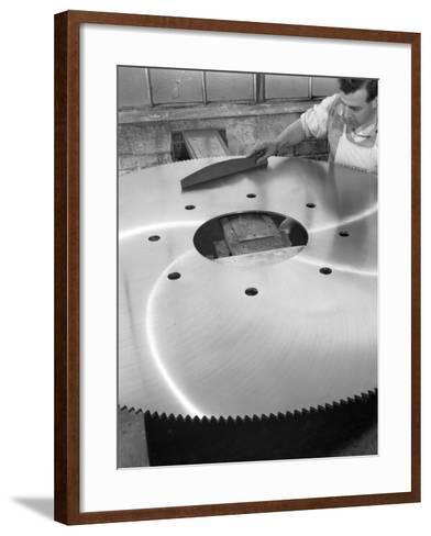 A Machinist Quality Checking a Six Foot Circular Saw Blade, Sheffield, South Yorkshire, 1963-Michael Walters-Framed Art Print