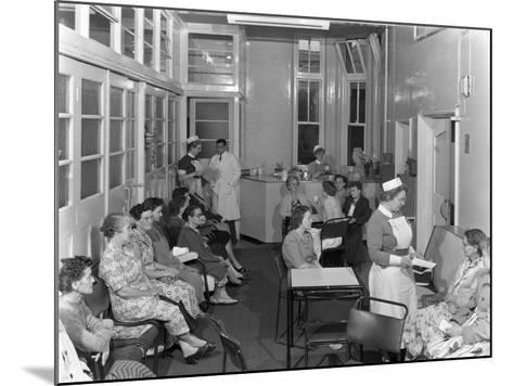 Outpatients Awaiting Treatement at the Montague Hospital, Mexborough, South Yorkshire, 1959-Michael Walters-Mounted Photographic Print