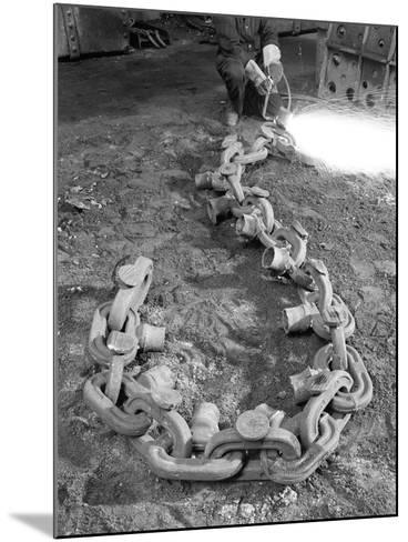 Cutting Off Lead from a Manganese Chain Casting, Sheffield, South Yorkshire, 1965-Michael Walters-Mounted Photographic Print