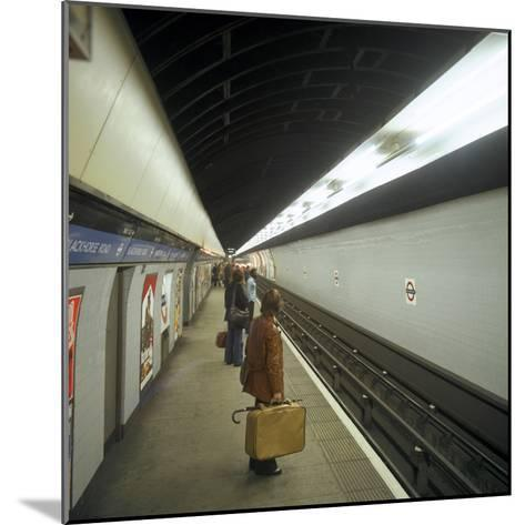 Passengers Waiting at Blackhorse Tube Station on the Victoria Line, London, 1974-Michael Walters-Mounted Photographic Print