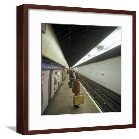 Passengers Waiting at Blackhorse Tube Station on the Victoria Line, London, 1974-Michael Walters-Framed Art Print