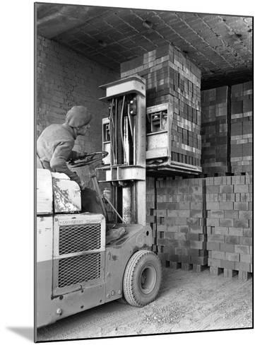 A Yardsman Stacking Pallets of Bricks, Whitwick Brickworks, Coalville, Leicestershire, 1963-Michael Walters-Mounted Photographic Print