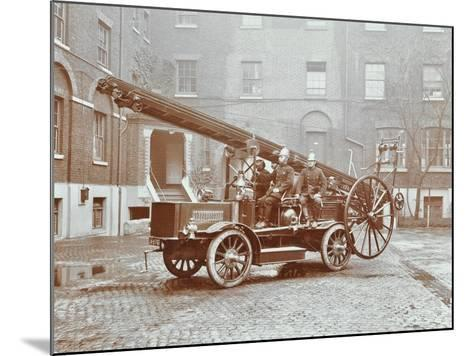 Firemen Aboard a Motor Fire Escape Vehicle, London Fire Brigade Headquarters, London, 1909--Mounted Photographic Print