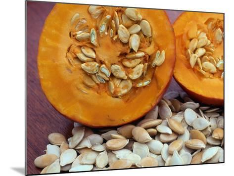 Sliced Pumpkin with Pumpkin Seeds (Cucurbita Sp) Europe-Reinhard-Mounted Photographic Print