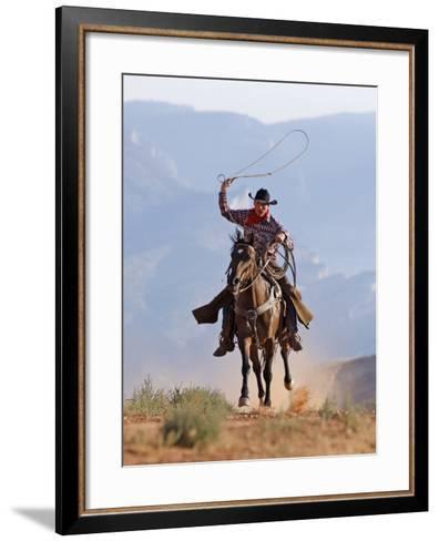 Cowboy Running with Rope Lassoo in Hand, Flitner Ranch, Shell, Wyoming, USA-Carol Walker-Framed Art Print