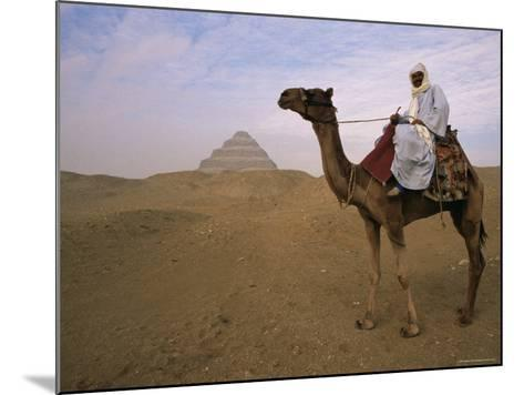 Bedouin Camel Rider in Front of Pyramid of Djoser, Egypt, North Africa-Staffan Widstrand-Mounted Photographic Print