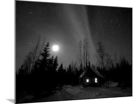 Cabin under Northern Lights and Full Moon, Northwest Territories, Canada March 2007-Eric Baccega-Mounted Photographic Print