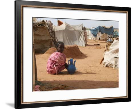 A Girl Washes Plates for Her Family in the North Darfur Refugee Camp of El Sallam October 4, 2006-Alfred De Montesquiou-Framed Art Print