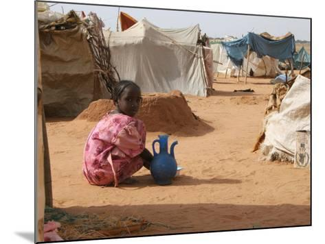 A Girl Washes Plates for Her Family in the North Darfur Refugee Camp of El Sallam October 4, 2006-Alfred De Montesquiou-Mounted Photographic Print