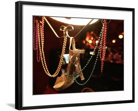 A Woman's High Heeled Shoe Hangs with Some Mardi Gras Beads--Framed Art Print