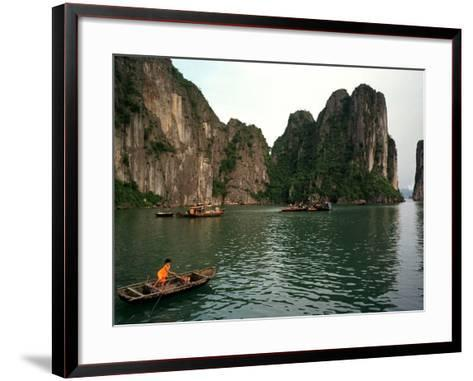 Boats Move Among the Craggy Islands of Halong Bay--Framed Art Print