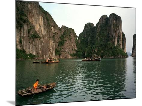 Boats Move Among the Craggy Islands of Halong Bay--Mounted Photographic Print