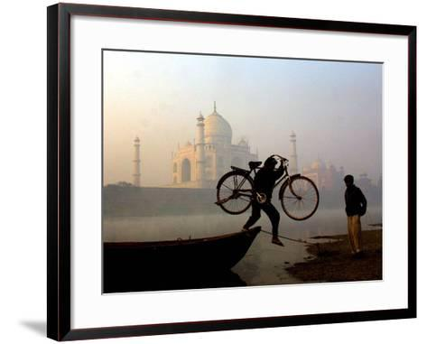 An Unidentified Cyclist Gets Down with His Cycle against the Backdrop of the Taj Mahal--Framed Art Print