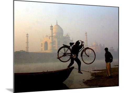 An Unidentified Cyclist Gets Down with His Cycle against the Backdrop of the Taj Mahal--Mounted Photographic Print