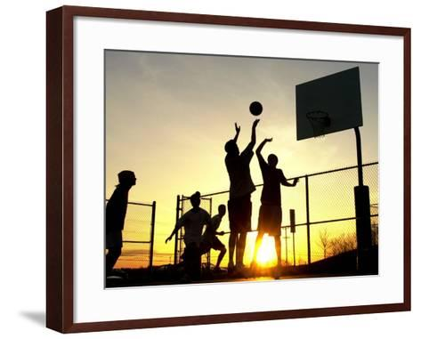 Students Play a Basketball Game as the Sun Sets at Bucks County Community College--Framed Art Print