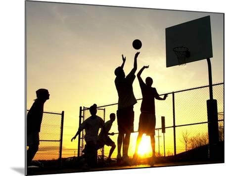 Students Play a Basketball Game as the Sun Sets at Bucks County Community College--Mounted Photographic Print