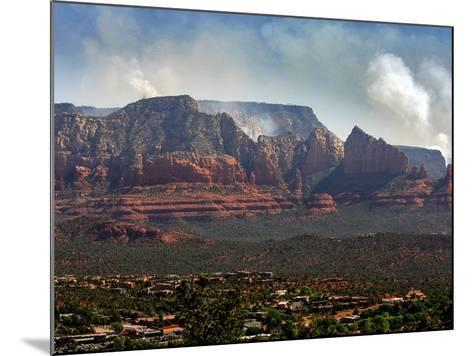 Sedona, Ariz. is Backdropped by the Brins Fire Buring Atop the Red Rocks--Mounted Photographic Print
