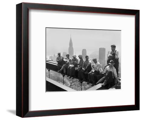 Construction Workers Take a Lunch Break on a Steel Beam Atop the RCA Building at Rockefeller Center--Framed Art Print