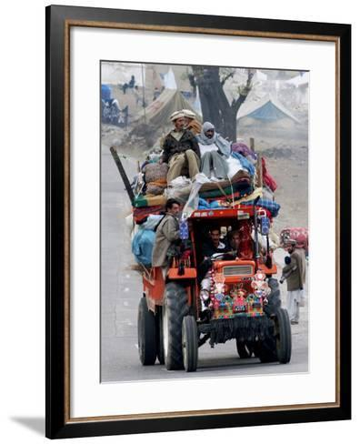 A Pakistan Earthquake Survivor Family Ride a Vehicle as They Make Their Way to Mansehra--Framed Art Print