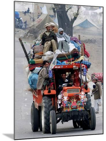 A Pakistan Earthquake Survivor Family Ride a Vehicle as They Make Their Way to Mansehra--Mounted Photographic Print