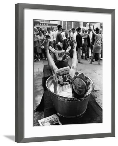 "Protesters Sit in Bath Tubs and Read the Satirical Newspaper ""Pardon""--Framed Art Print"