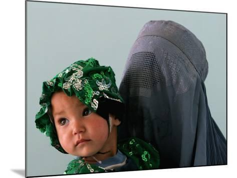 An Afghan Mother Waits with Her Daughter Before Attending Medical Care--Mounted Photographic Print
