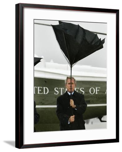 President Bush Jokingly Holds His Wind-Blown Umbrella Upright--Framed Art Print