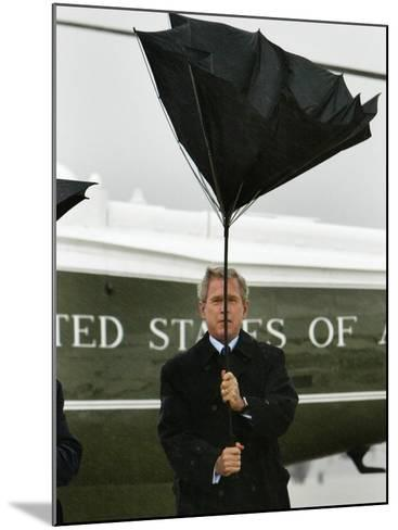 President Bush Jokingly Holds His Wind-Blown Umbrella Upright--Mounted Photographic Print