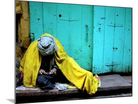 A Muslim Man Warms Himself--Mounted Photographic Print